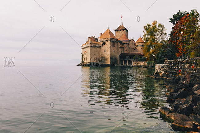 Chillon Castle by Lake Geneva against cloudy sky