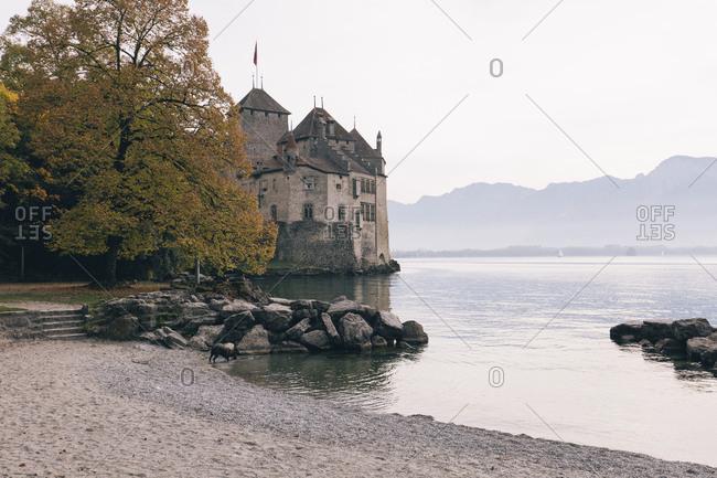 Chillon Castle by Lake Geneva against sky