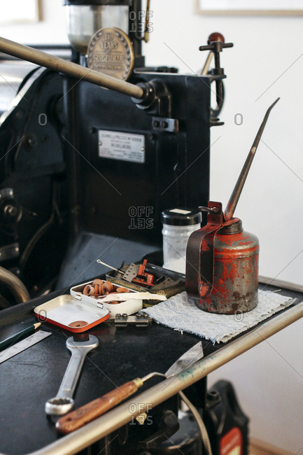 Equipment on table by screen printing press in workshop