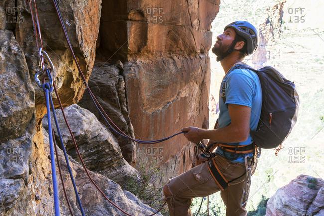 Male hiker climbing mountain