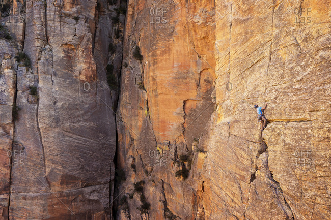 Full length of man climbing mountain