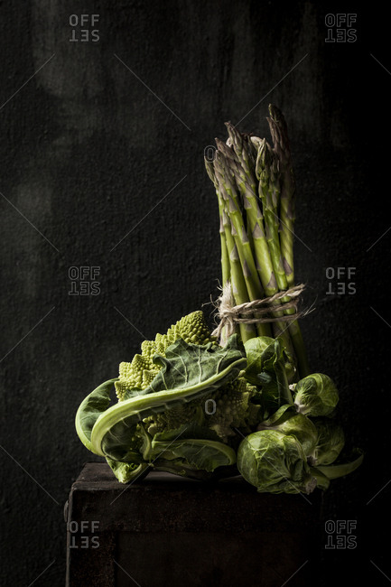 Romanesco Cauliflower with Brussels sprouts and asparagus on wooden table