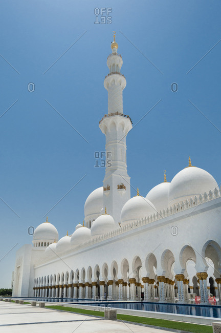 United Arab Emirates, Abu Dhabi - July 3, 2013: Sheikh Zayed Mosque against clear blue sky during sunny day