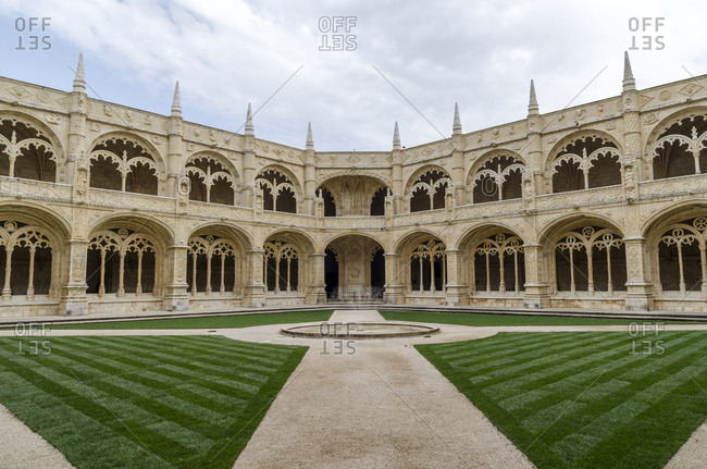 Wide angle view of repeating patterns, inner courtyard at Jeronimos Monastery in Lisbon