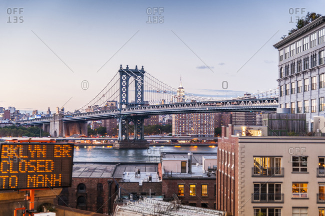 USA, New York, Manhattan . Skyline of Manhattan and view of Manhattn Bridge from Brooklyn Bridge