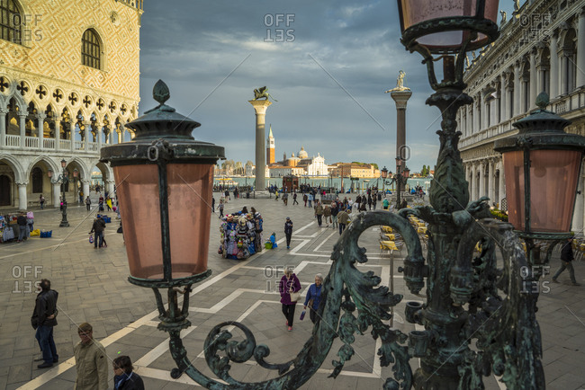 Italy, Veneto, Venice - April 23, 2015: Piazzetta San Marco, with view of Biblioteca Marciana Palace,Palazzo Ducale and San Giorgio Maggiore church in the middle of the lagoon