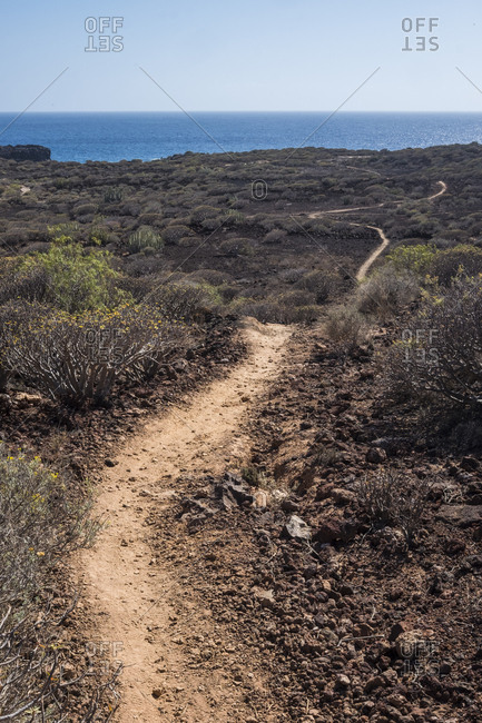 Hiking trail leading through a plain on an island near the sea