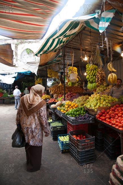 Woman walking in a market