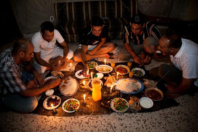 Beirut, Lebanon - September 12, 2008: Men dining on floor together