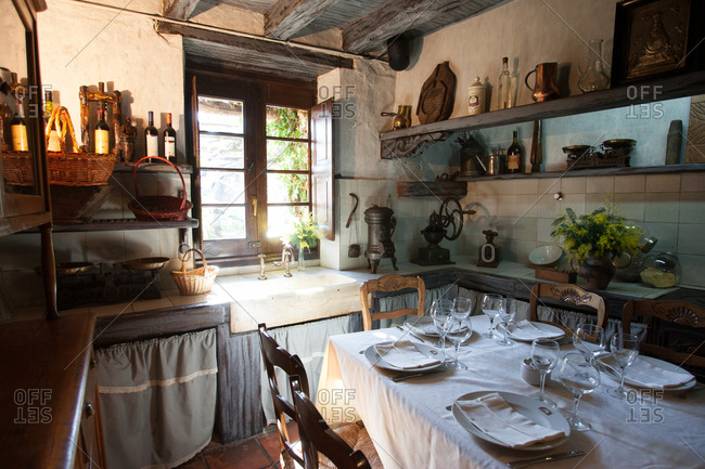 Basque Country, Spain - January 29, 2007: Table set in cozy farmhouse kitchen