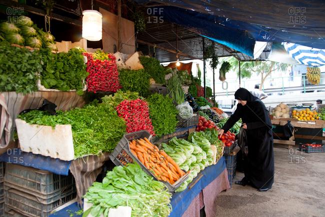 Beirut, Lebanon - September 14, 2008: Woman shopping in produce market