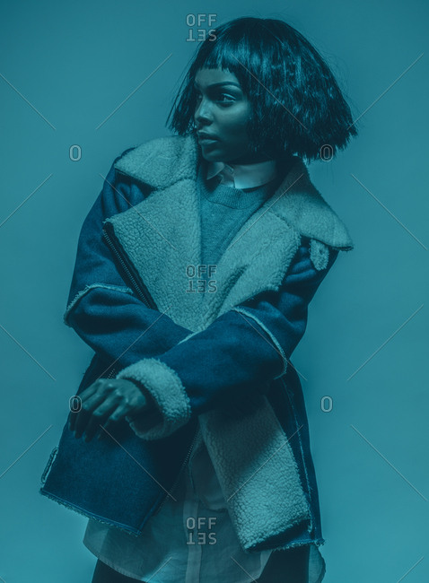 Model posing in a blue tint