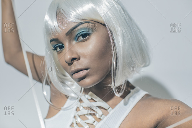 Model in white wig and hoop earrings