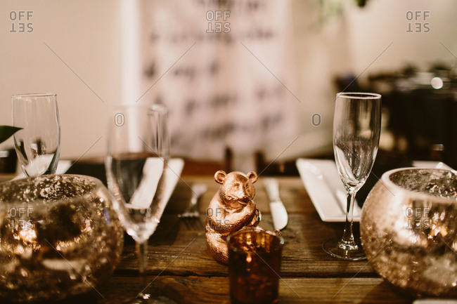 Table setting with champagne flutes and gold decor