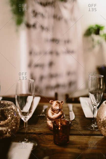 Dining table setting with gold decor