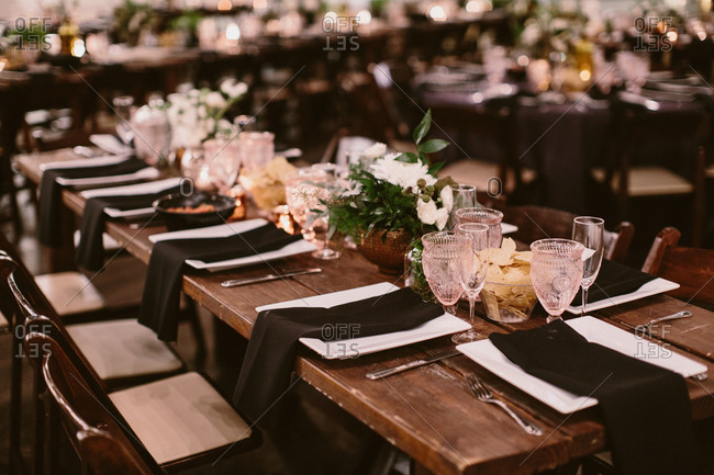 Party table setting with greenery in glass jars