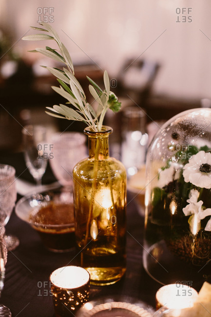 Centerpiece with greenery and candles