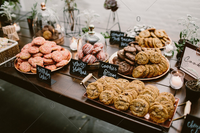 Dessert table of cookies with floral and candle decor