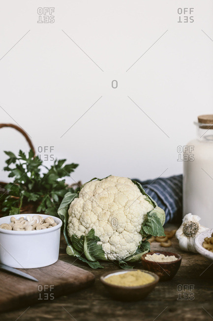 Fresh cauliflower and ingredients for mac and cheese