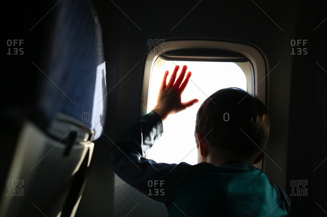 Boy at window of a plane