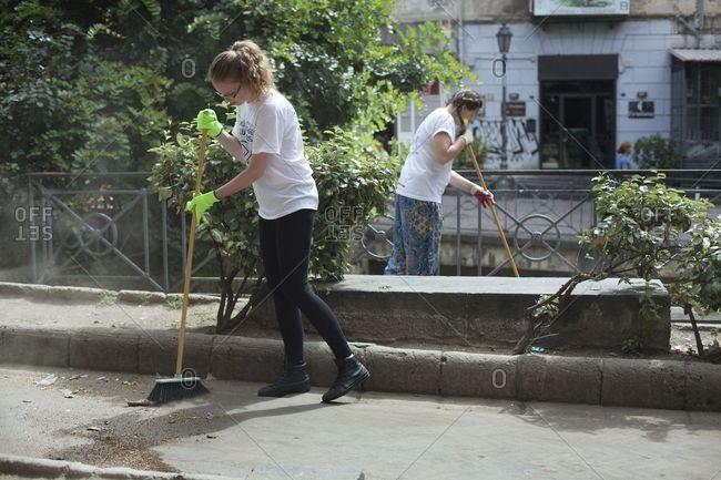 Naples, Italy - June 24, 2013: Volunteers helping clean city