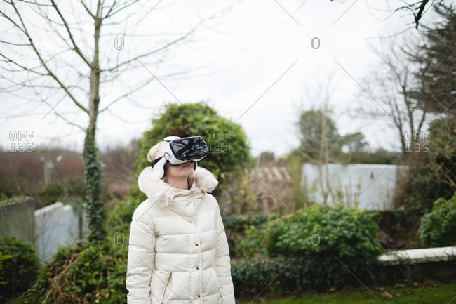 Woman in fury coat using virtual reality headset