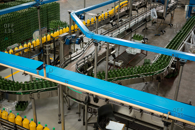 High angle view of cold drink bottles on production line