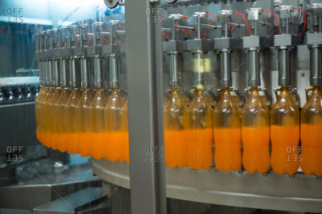 Bottles being filled with juice on production line