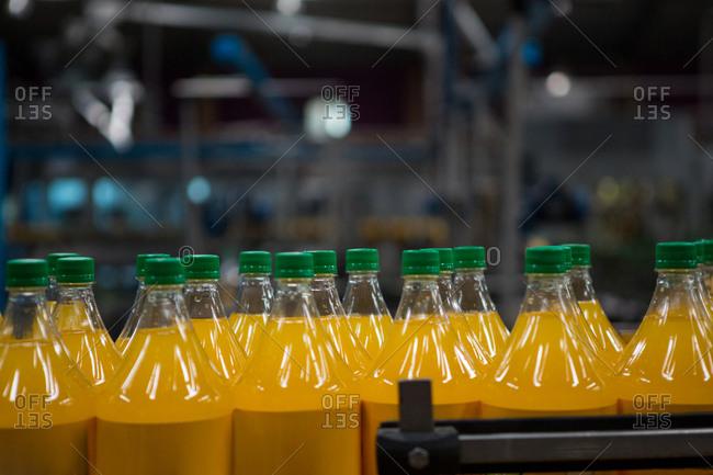 Yellow juice bottles in factory