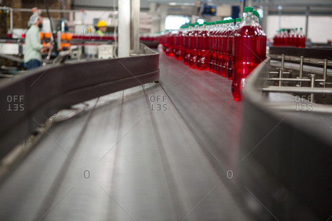 Juice bottles on production line in manufacturing industry