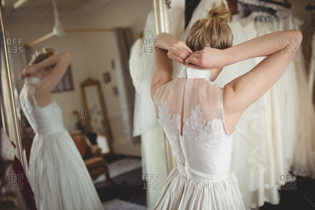 Rear view of bride wearing wedding dress