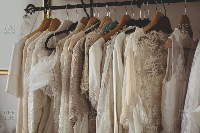 Variety of wedding dresses in wardrobe