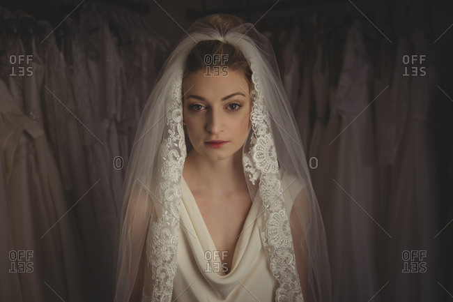 Young bride in a white dress in a boutique
