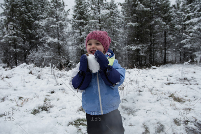 Girl holding snowball on beautiful snowy day