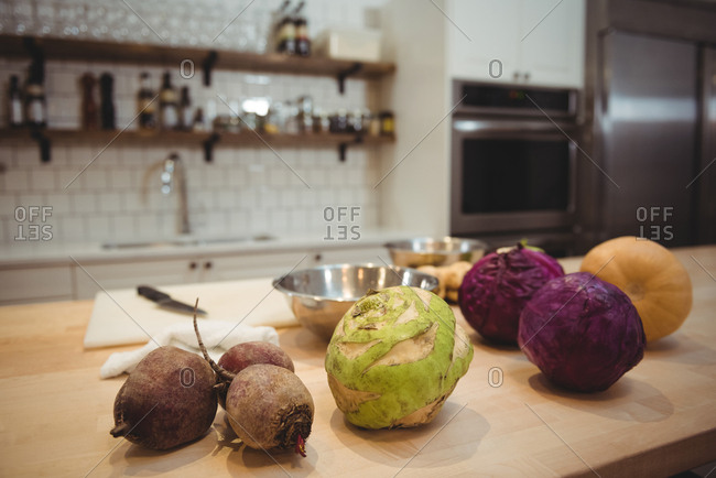Fresh vegetables on counter in commercial kitchen