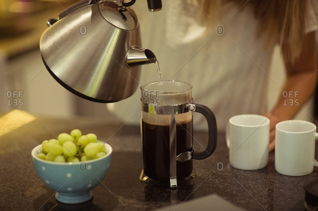 Woman preparing coffee at home