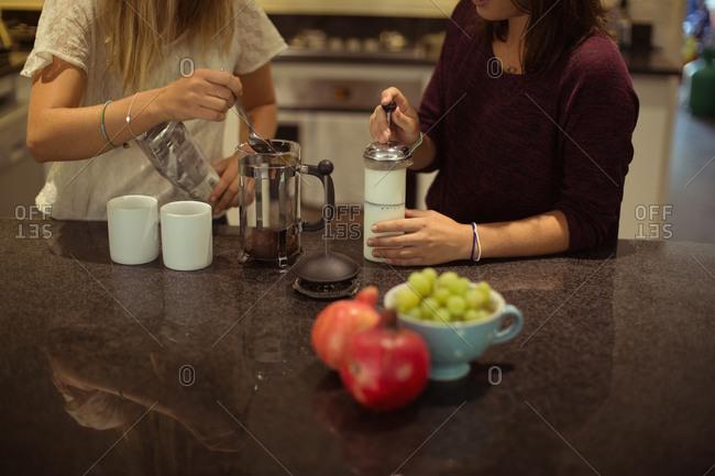 Friends preparing coffee