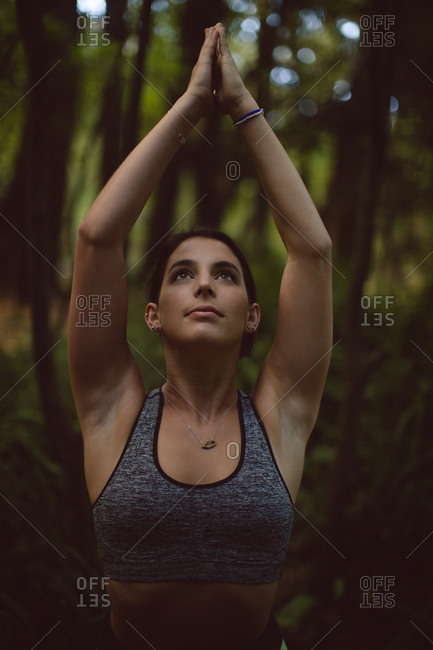Woman performing yoga in the forest