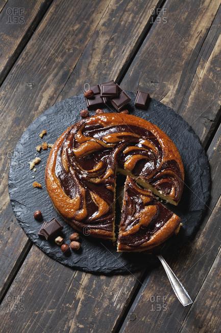 Sliced chocolate cake on slate plate