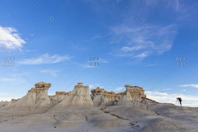 USA- New Mexico- San Juan Basin- Valley of Dreams- Badlands- Ah-shi-sle-pah Wash- sandstone rock formation- hoodoos with photographer