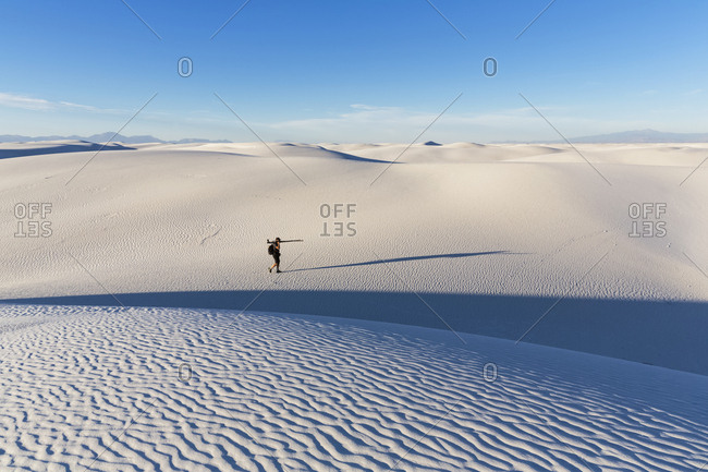USA- New Mexico- Chihuahua Desert- White Sands National Monument- photographer on dune