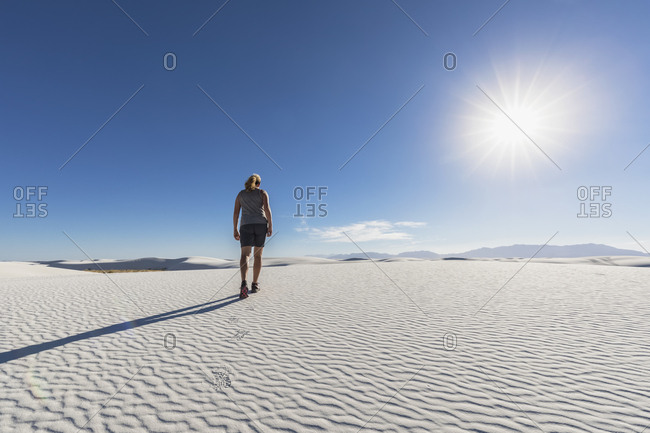 USA- New Mexico- Chihuahua Desert- White Sands National Monument- woman hiking on dune