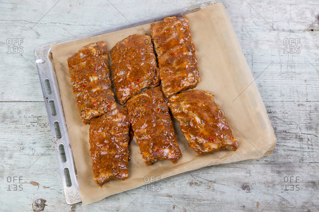 Marinated raw spare rips on baking tray