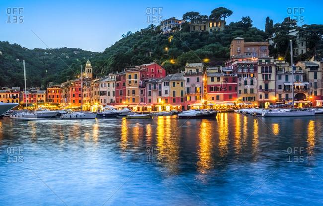 Italy- Liguria- Portofino- boats in harbor at blue hour