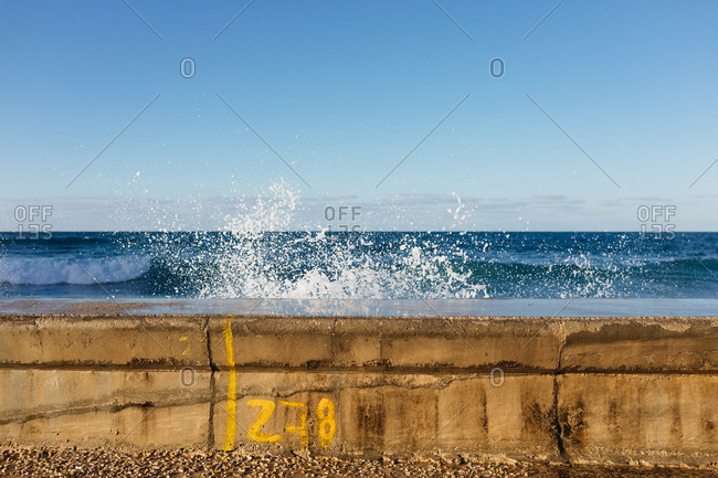 Ocean waves crashing against the Malecon seawall in Havana