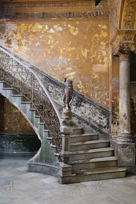 Winding staircase in a worn down building in Old Havana