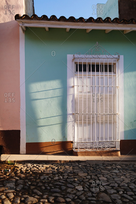 Sun setting on the entrance of colorful houses in Trinidad, Cuba