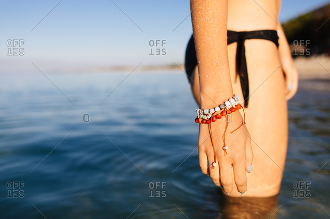Woman standing in the ocean at sunrise