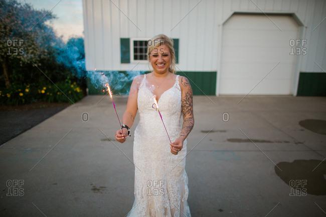 Bride holding sparklers