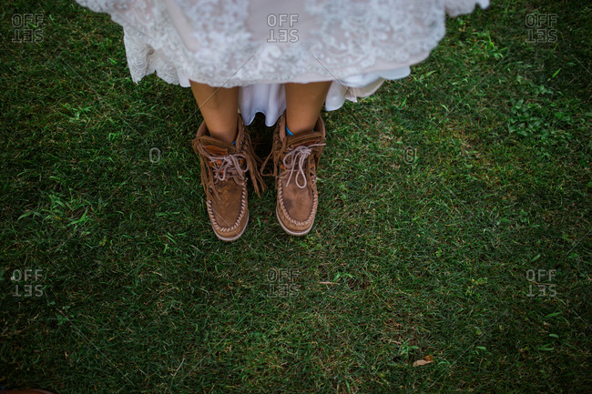 Bride wearing moccasin style boots